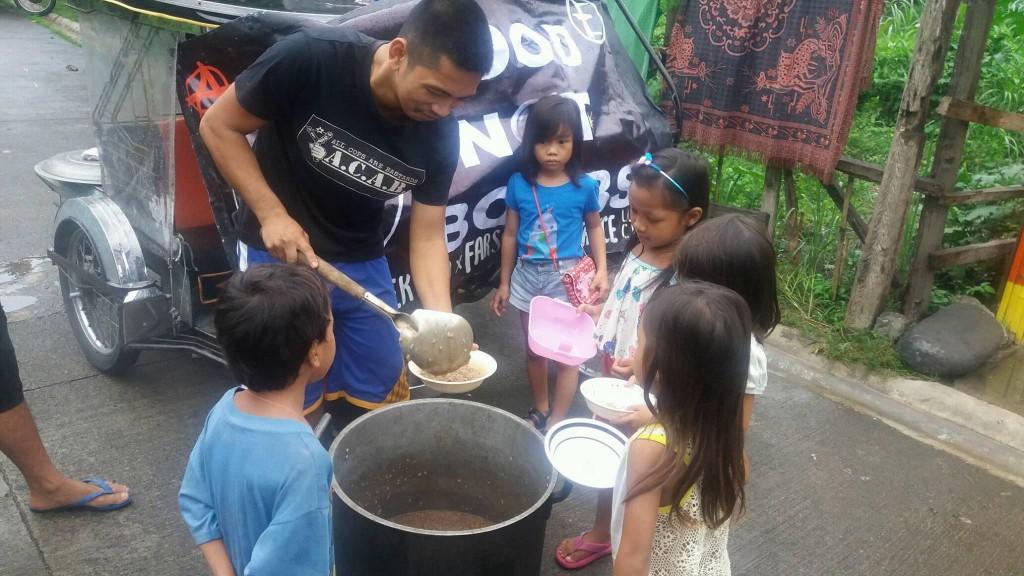Food Not Bombs volunteers share vegan meals in the Philipeans
